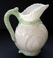 BELLEEK IRISH PORCELAIN TOY SHELL CREAM JUG - RARE GREEN COLOUR WAY, 1ST BLACK MARK C.1863-1890
