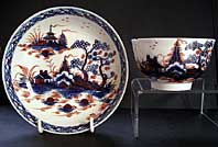 LIVERPOOL PORCELAIN RICHARD CHAFFERS BLUE AND WHITE IMARI TEABOWL AND SAUCER WITH CANNONBALL PATTERN LANDSCAPE C.1768
