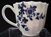EARLY WORCESTER BLUE AND WHITE WORKMAN'S MARK FLUTED COFFEE CUP. THE PRUNUS ROOT PATTERN BFS I.D. 27 C.1756
