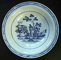 AN ENGLISH DELFTWARE TINGLAZED DEEP DISH AFTER A DESIGN BY JEAN PILLEMENT C.1760-65