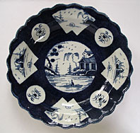 RARE FIRST PERIOD WORCESTER BLUE AND WHITE POWDER BLUE GROUND PLATE - FAN-PANELLED LANDSCAPE PATTERN BFS I.B.27 C.1770-80